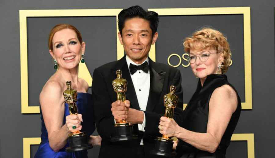 (From left) Anne Morgan, Kazu Hiro and Vivian Baker with their awards.