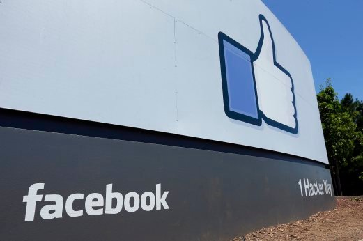 (File pix) This July 16, 2013 file photo shows a sign at Facebook headquarters in Menlo Park, Calif. Beginning with the new year, dads working full-time for Facebook anywhere in the world will have the option of taking four months' paid leave. AP Photo