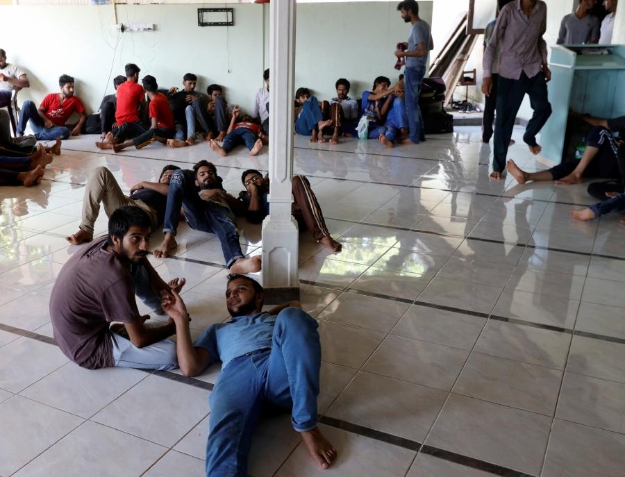 Pakistan refugees rest inside a mosque in Negombo, Sri Lanka.-Reuters
