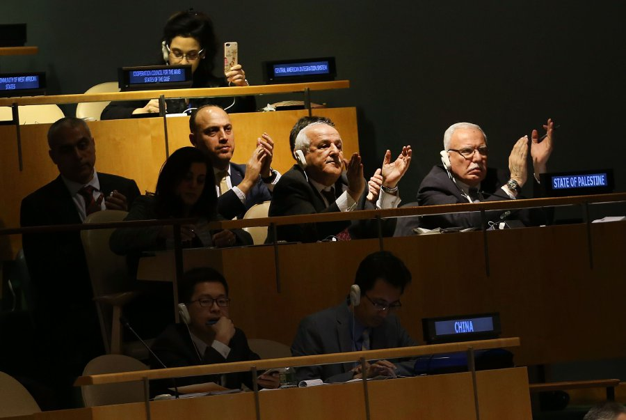 """Members of the Palestinian delegation leave the General Assembly hall after a vote on the floor of the United Nations General Assembly in which the United States declaration of Jerusalem as Israel's capital was declared """"null and void"""" on December 21, 2017 in New York City. The vote, 128-9, at the United Nations concerned Washington's decision to recognize Jerusalem as Israel's capital and relocate its embassy there. The Trump administration has threatened to take action against any country that votes against the United States decision to move its embassy. AFP pic"""