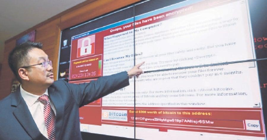 Datuk Dr Amirudin Abdul Wahab explaining the impact of WannaCry.