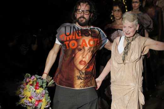 Designer Vivienne Westwood, right, receives applause at the end of her ready to wear, fall-winter 2015-2016 fashion collection during Paris Fashion Week. AP Photo