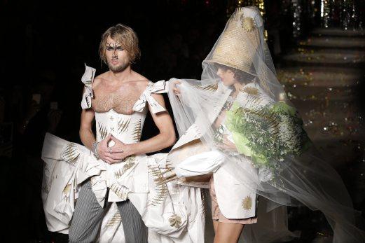 Models wear a creation for Vivienne Westwood's ready-to-wear Fall-winter 2015-2016 fashion collection during the Paris Fashion Week, in Paris. AP Photo