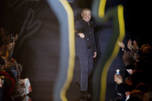 Lebanese designer Elie Saab appears at the end of his Autumn/Winter 2015/2016 women's ready-to-wear collection show at Paris Fashion Week. REUTERS