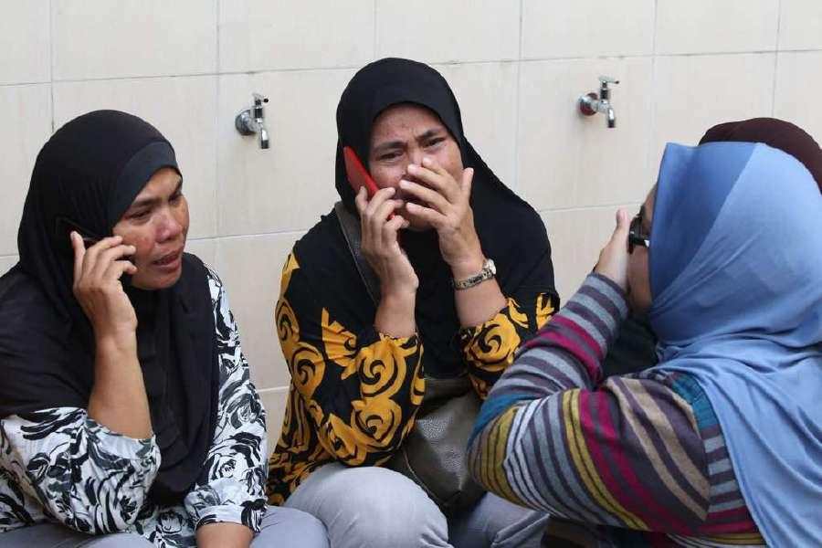 Family members seen outside the tahfiz school in Datuk Keramat that caught fire this morning. Pix by Mohd Yusni Ariffin