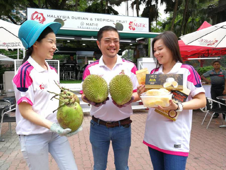 (File pix) (From left) Matic Food and Beverage Sdn Bhd manager Rose Chin, managing director Datuk Seri Roger Ly Kim Cheong and wife Kimberly Ng with the variety of durians and packed items at the durian booth at the Malaysia Tourism Centre in Jalan Ampang, Kuala Lumpur. Pix by Adrian David