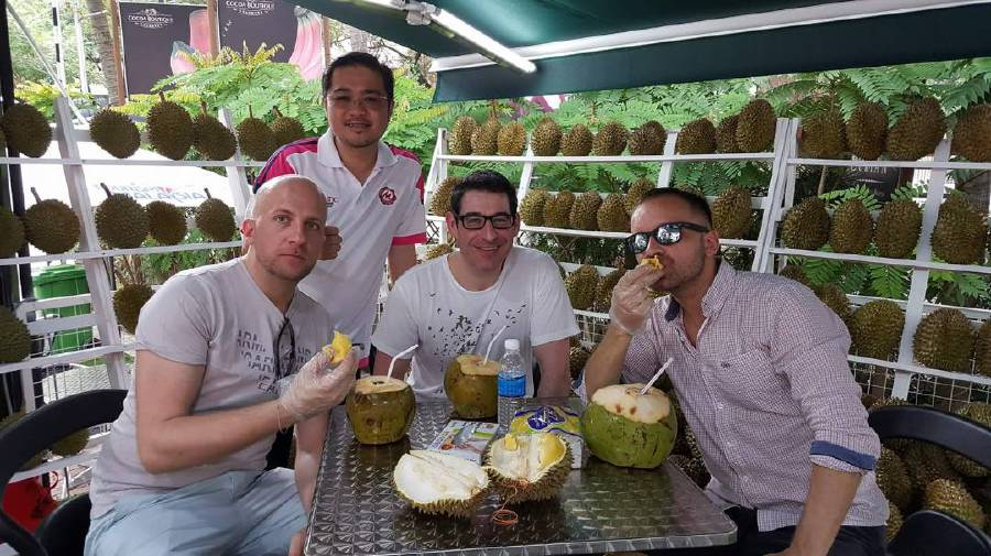 (File pix) Matic Food and Beverage Sdn Bhd managing director Datuk Seri Roger Ly Kim Cheong (standing) with some European guests at his durian booth at the Malaysia Tourism Centre in Jalan Ampang, Kuala Lumpur. Pix by Adrian David