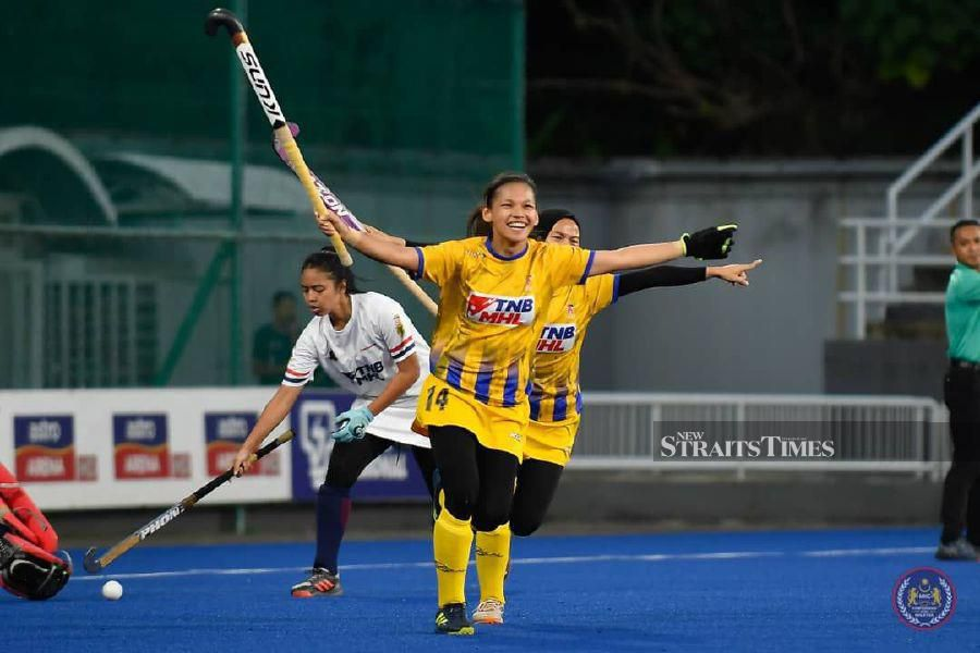 UniTen's Nur Zafirah Aziz celebrates scoring against HockAdemy