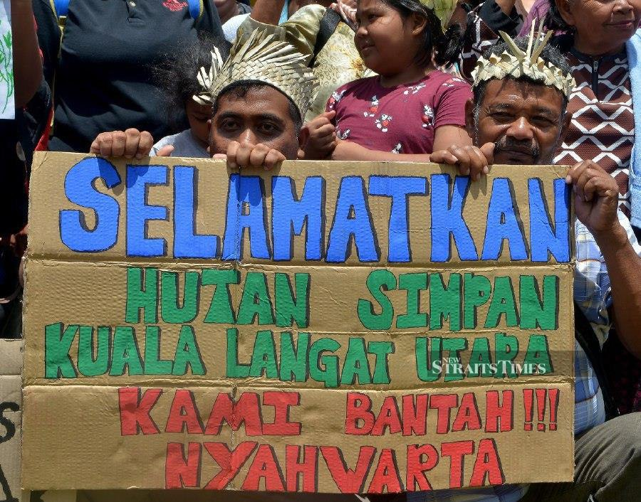 Tok Batin Sari Senin from Kampung Busut Baru was struggling to hold back tears as he made his plea to save the Kuala Langat North Forest Reserve which has been proposed for degazettement. - STR/FAIZ ANUAR