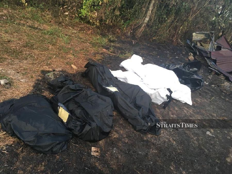 Remains of some of the family members seen following the fire at Kampung Bandau, Membakut. -NSTP