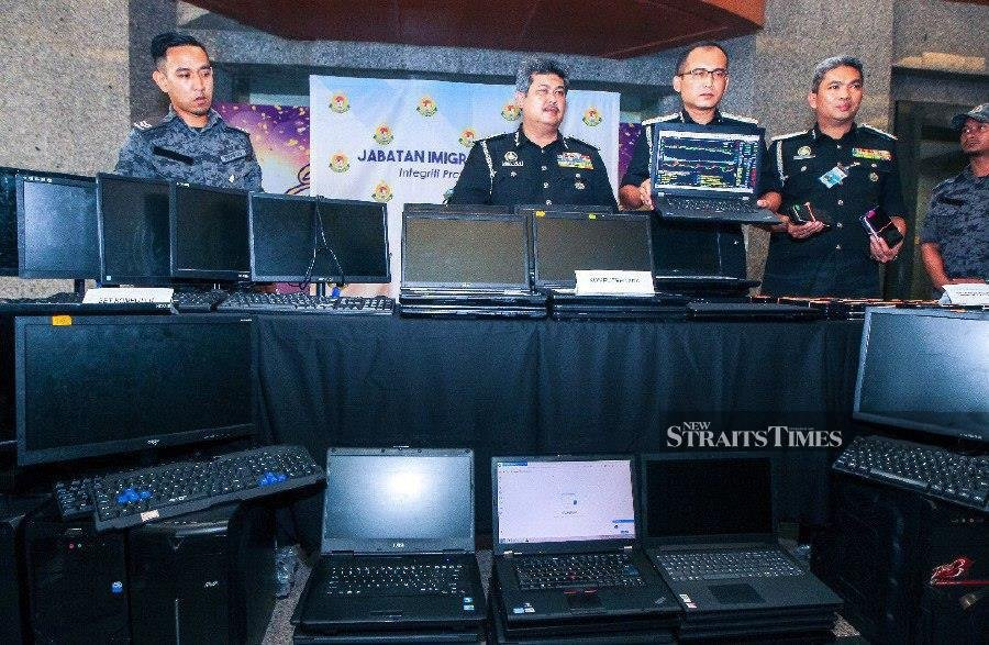 Immigration officers also seized 8,230 mobile phones, 174 laptops and 787 personal computers.NSTP/LUQMAN HAKIM ZUBIR