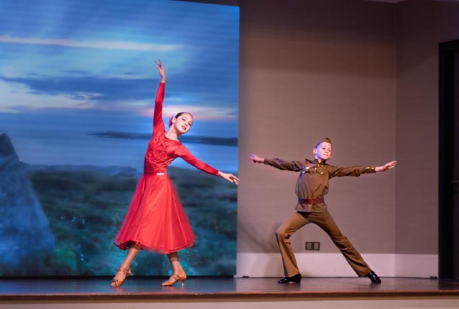 Russian School pupils Nazar Kanyukov (right) and Maria Belevich peforming a duet as a soldier and his dance partner at the 102nd Russian Armed Forces Day at the JW Marriott Hotel in Jalan Bukit Bintaing, Kuala Lumpur. -Pic courtesy of the Russian embassy