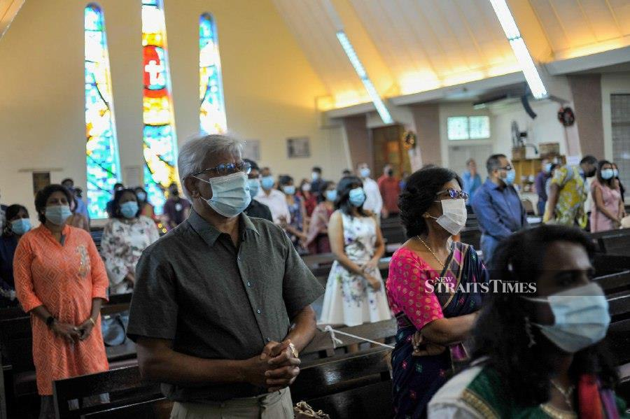 Churchgoers observing the SOP while attending the service in Methodist Tamil Church in Brickfields.  - NSTP/AIZUDDIN SAAD