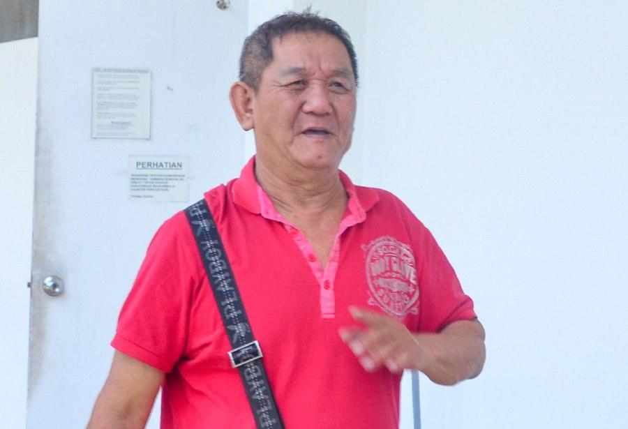 Ang Hock Beng arrives at the Balik Pulau Magistrate's Court. NSTP/DANIL SAAD