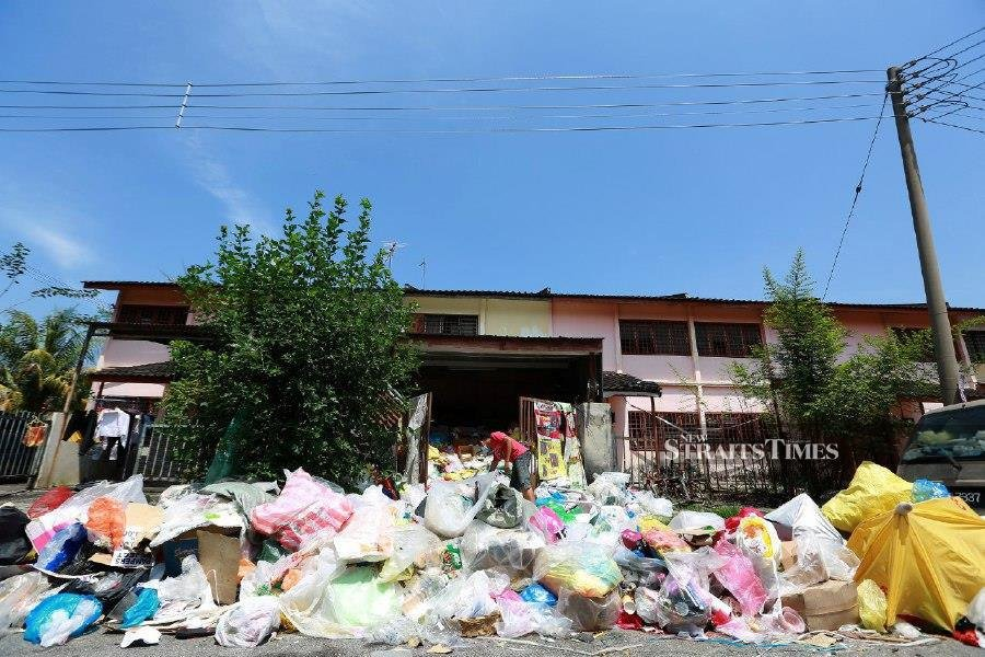 Sulaiman Abd Majid looks at the pile of rubbish at the house in Taman Bersatu, Simpang Pulai. -NSTP/SHARUL HAFIZ ZAM
