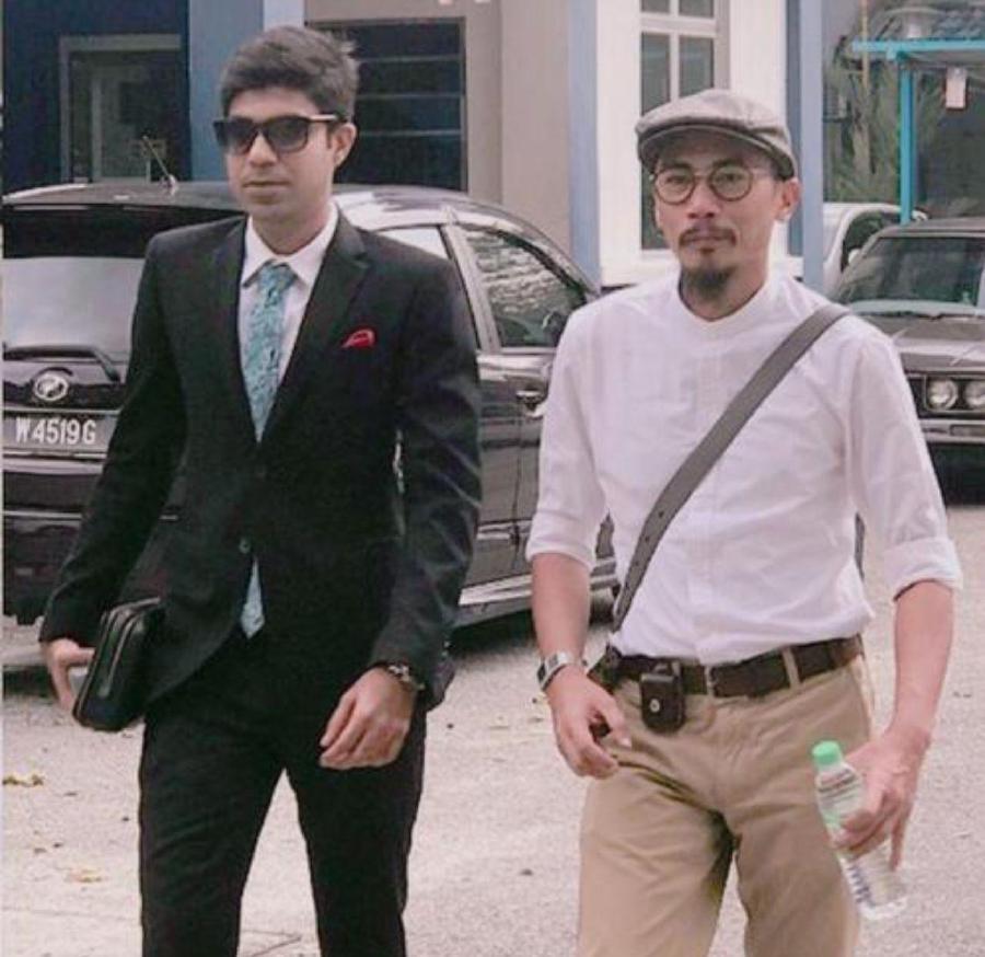 Taj Innuendo (right) seen here with his lawyer Mohamed Ashmeer Ashrof Raja.