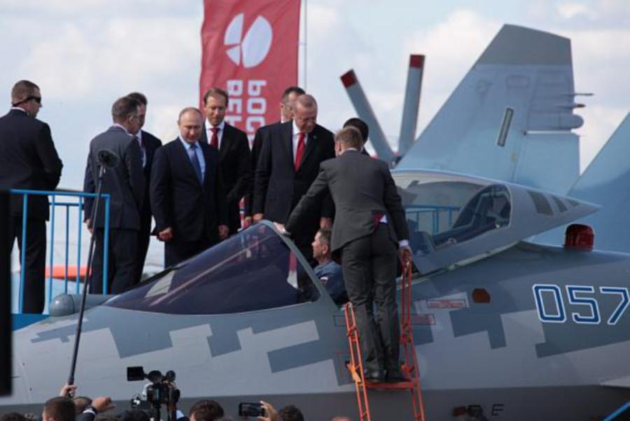 Russian president Vladimir Putin and Turkish President Recep Tayyip Erdogan checking out the cockpit of Su-57 jet fighter. -- Courtesy pic