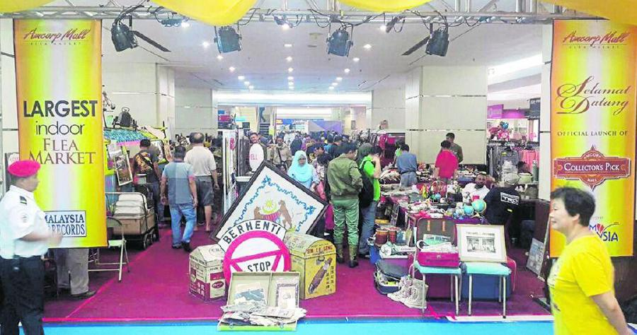 Flea markets, like this indoor market in Kuala Lumpur, are great platforms to showcase tourism-related products. - File pic