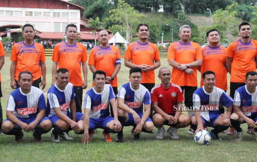 Senior Education Minister Dr Radzi Jidin joined a friendly football match with the local community and teachers at SMK Gunsanad II in Sabah today. - NSTP/MALAI ROSMAH TUAH