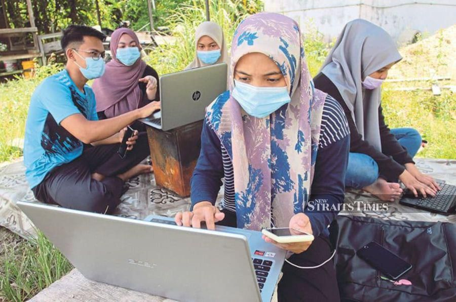 Universiti Teknikal Malaysia Melaka students trying to get Internet connection outdoors. Higher education institutions should help students cope with anxiety during the pandemic. - NSTP/NIK ABDULLAH NIK OMAR