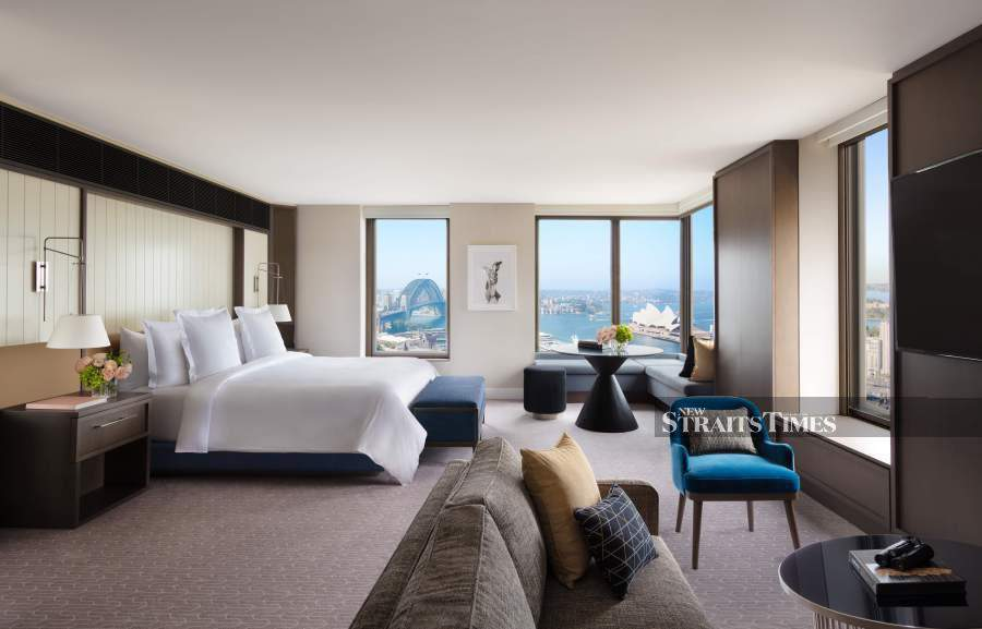 A newly renovated and tastefully decorated room with full view of the Sydney Harbour.