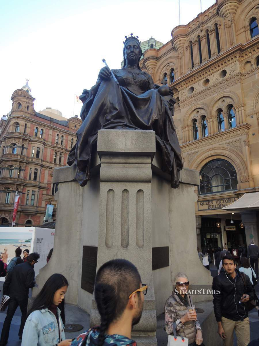 The statue of Queen Victoria stands at the corner of Druitt Street and George Street.