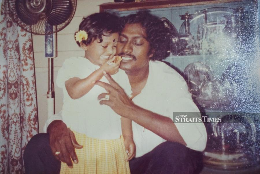 Visithra and her late father.