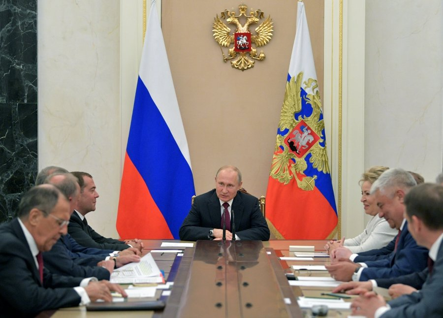Russian President Vladimir Putin chairs a meeting with members of the Security Council at the Kremlin in Moscow.-Reuters