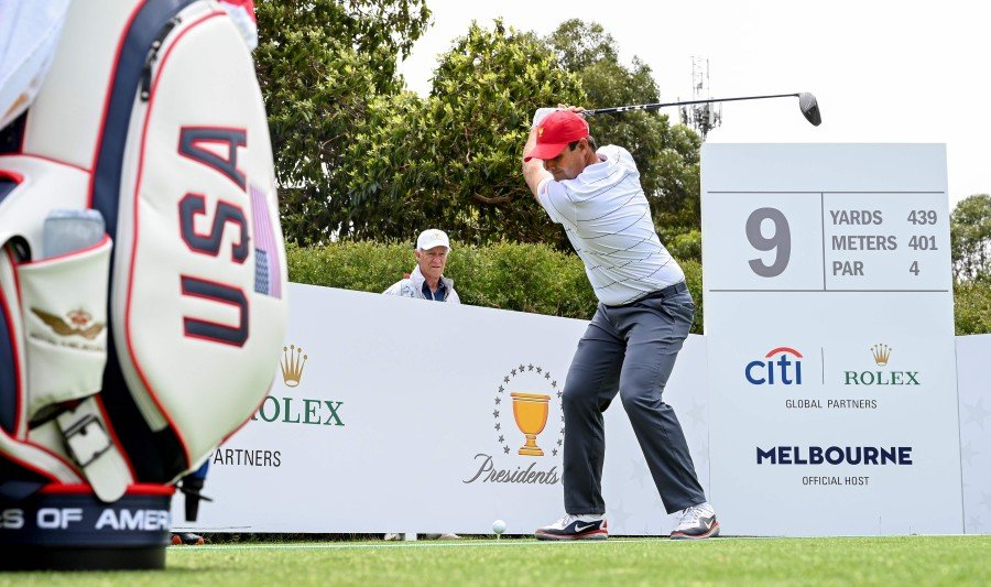 US player Patrick Reed tees off during a practice round ahead of the Presidents Cup golf tournament in Melbourne. -AFP