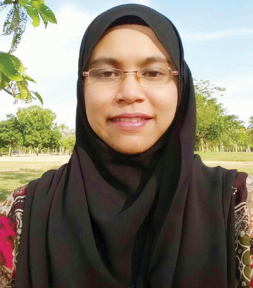 Rafidah Muhamad, 40, government servant and mother of Adam Akmal (Year 6), Alia Alisya (Year 5) and Amir Akram (Year 1).