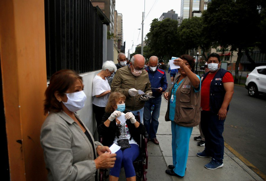 Elderly patients line up outside of a health center after the Peruvian government closed the country's borders in response to the outbreak of coronavirus disease (COVID-19), in Lima, Peru. - AFP pic