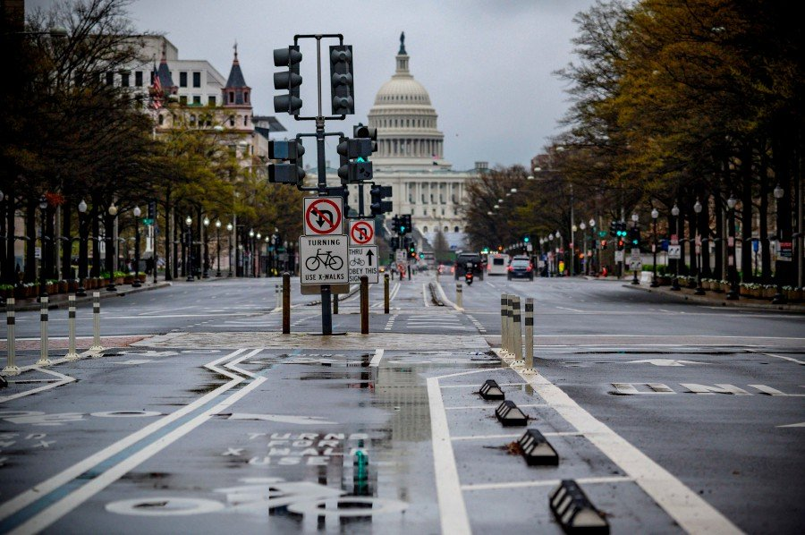 Pennsylvania avenue, one of the largest avenues of the US Capital, is almost deserted by traffic during the 6pm usual rush hour in Washington. - AFP pic