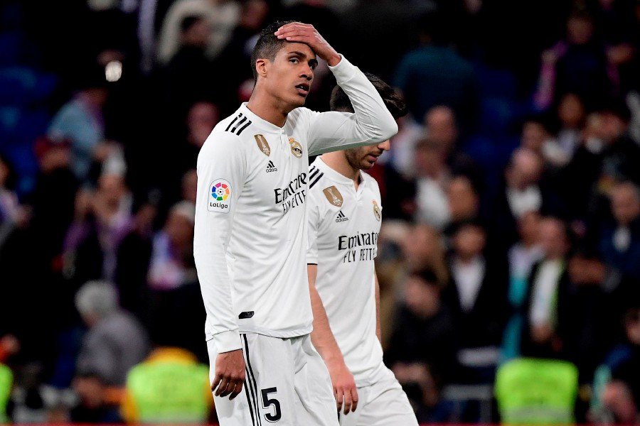 38786f34235 Real Madrid s French defender Raphael Varane reacts at the end of the Spanish  league football match between Real Madrid CF and FC Barcelona at the  Santiago ...