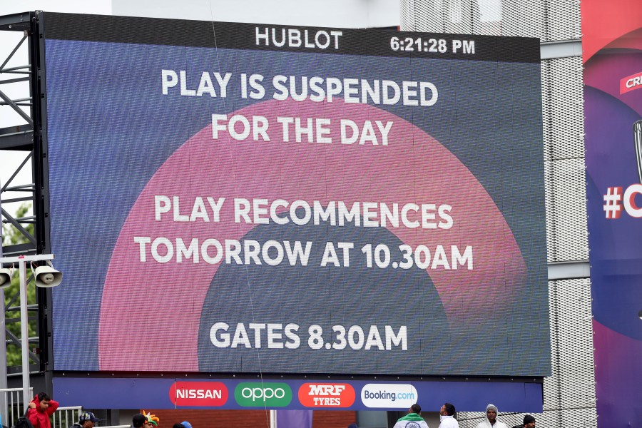 General view of the big screen after rain stopped play. - Reuters