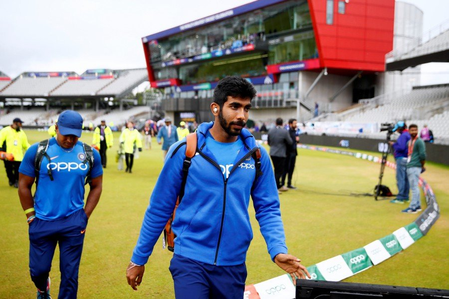 India's Jasprit Bumrah leaves after rain stopped play. - Reuters