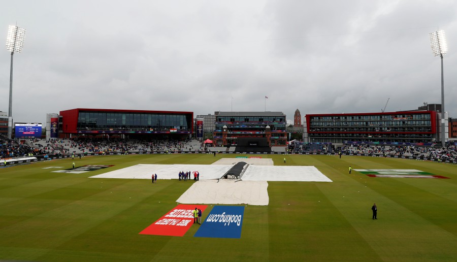 General view of the pitch as play is stopped due to rain. - Reuters