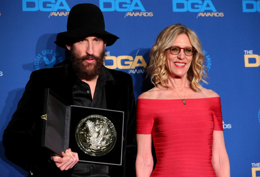 Outstanding Directorial Achievement in Movies for Television and Limited Series winer Sweedish director Johan Renck poses alongside actress Christine Lahti in the press room during the 72nd Annual Directors Guild of America Awards at the Ritz Carlton Hotel in Los Angeles. -Reuters