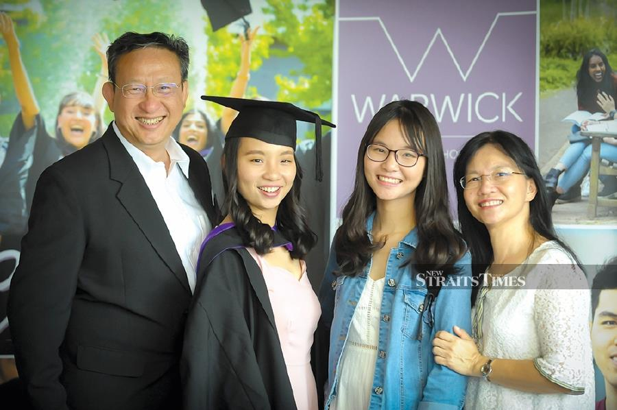 Rhodes scholar 2020 Ong June Han (second from left) with her family at her graduation ceremony at the University of Warwick, England.