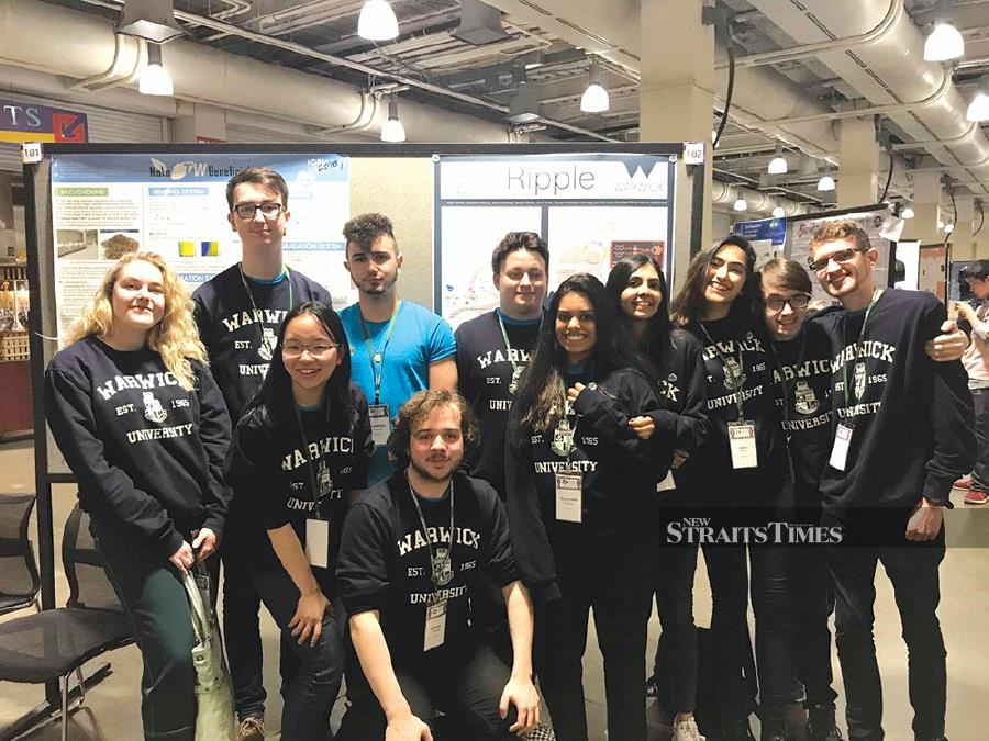 Ong June Han (front row, second from left) with the University of Warwick team at the International Genetically Engineered Machine Competition (iGEM) in Boston, United States.