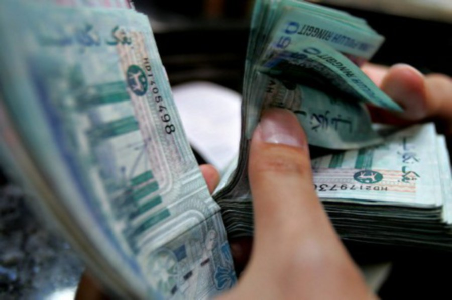At 9.07am, the local currency was quoted at 4.1460/1500 against the greenback, compared with yesterday's close of 4.1400/1450. -AFP/File pic