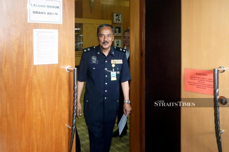 Witness, Former Padang Besar District Police Chief, Superintendent Rizani Che Ismail left the proceedings room after testifying during the public hearings session of the Royal Commission of Inquiry (RCI) on the discovery of temporary campsites and graves at Wang Kelian, Perlis in Putrajaya. NSTP/MOHD FADLI HAMZAH