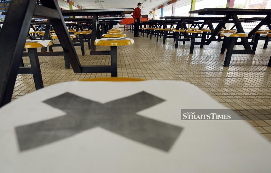 School canteens are places where students needs to observe social distancing, but it may be a challenge for teachers to ensure they follow the ruling. - NSTP/File pic