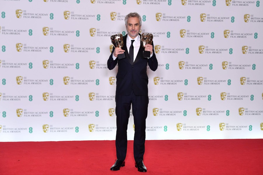 Mexican director Alfonso Cuaron poses with the awards for a Director and  for Best Film for 'Roma' at the BAFTA British Academy Film Awards at the  Royal ...