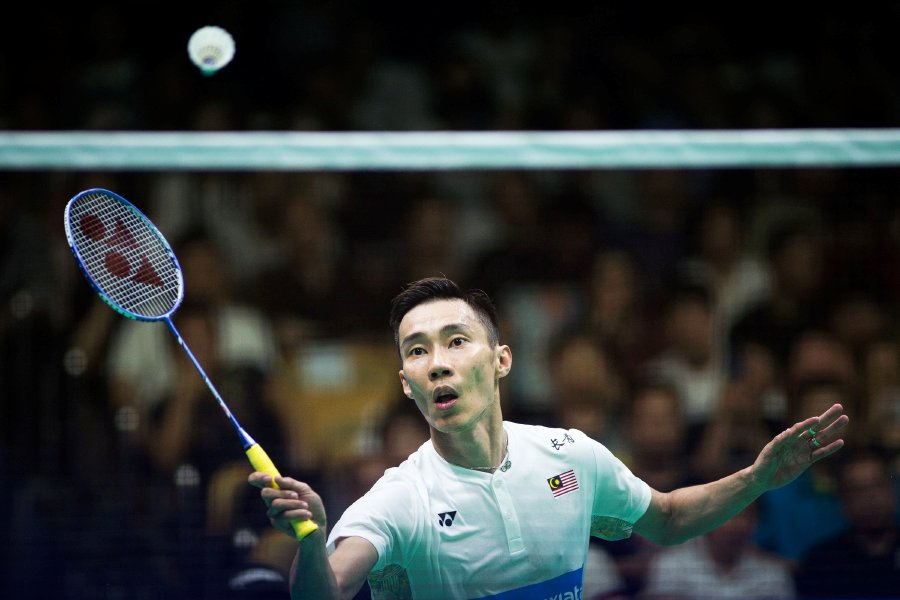 Japan ace stuns Chen for badminton title