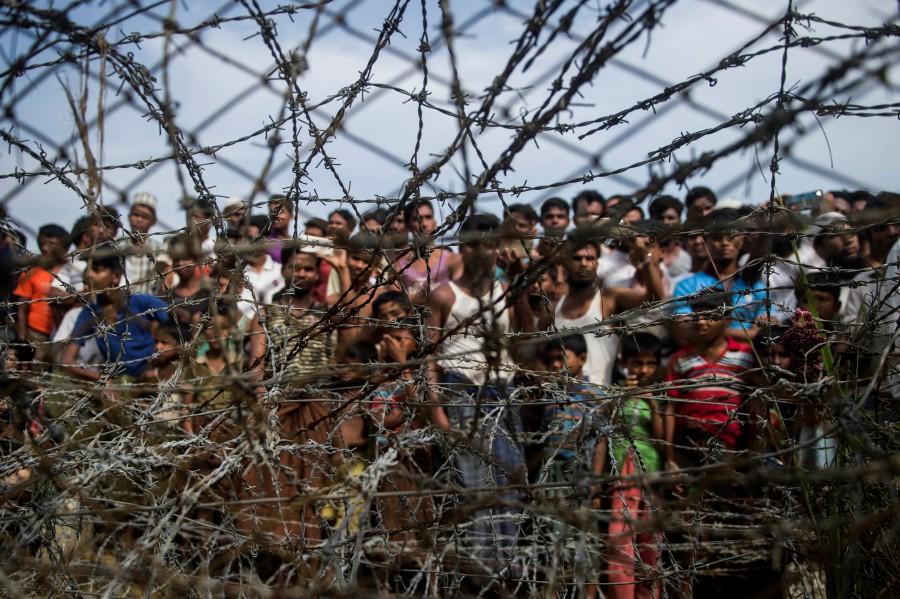 "In this file photo taken on April 25, 2018, taken from Maungdaw district, Myanmar's Rakhine state on April 25, 2018 shows Rohingya refugees gathering behind a barbed-wire fence in a temporary settlement setup in a ""no man's land"" border zone between Myanmar and Bangladesh. -AFP pic"
