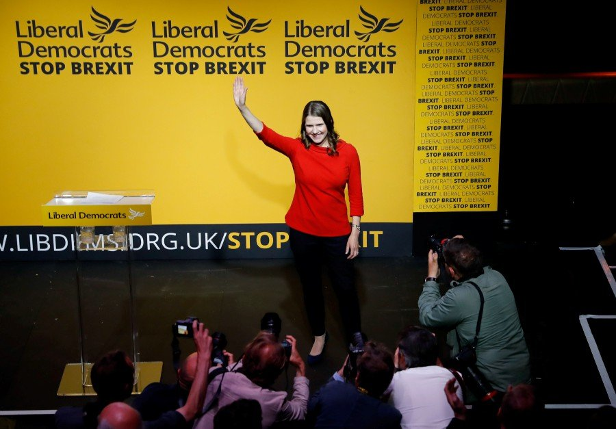 New Liberal Democrat leader Jo Swinson waves on stage at an event announcing the result of the leadership contest in central London. - AFP