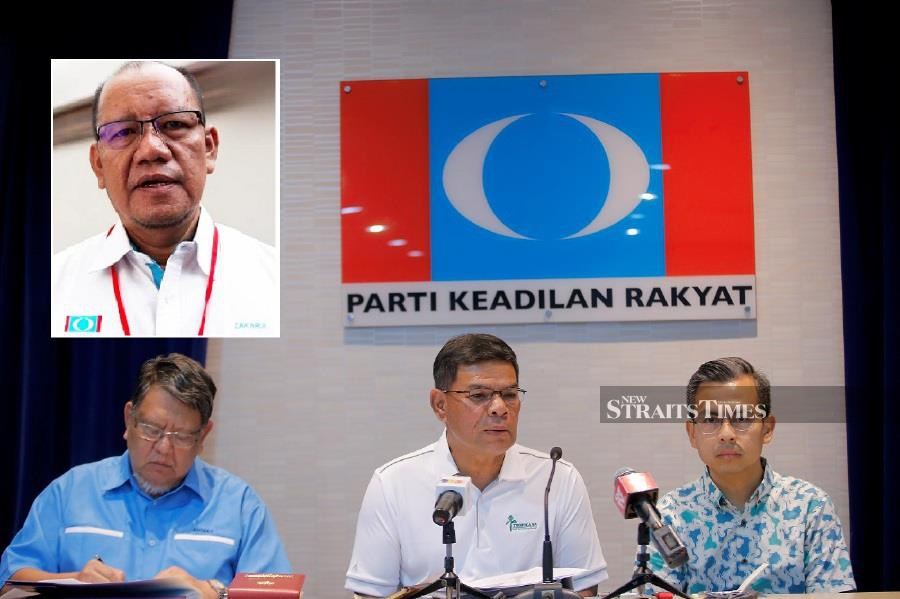 PKR secretary-general Datuk Seri Saifuddin Nasution Ismail (centre) speaking at a press conference after the party's Central Leadership Council meeting in Petaling Jaya on Sunday. PIC BY MUHD ZAABA ZAKERIA