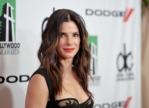 FILE - In this Oct. 21, 2013 file photo, Sandra Bullock arrives at the 17th Annual Hollywood Film Awards Gala at the Beverly Hilton Hotel in Beverly Hills, Calif. Police arrested an intruder on Sunday morning, June 8, 2014, at the Los Angeles home of Bullock while the actress was there, but she wasn't hurt. Los Angeles police spokeswoman Nuria Vanegas says police responded to the call of a prowler at about 6:30 a.m. and arrested 39-year-old Joshua Corbett on suspicion of residential burglary. AP