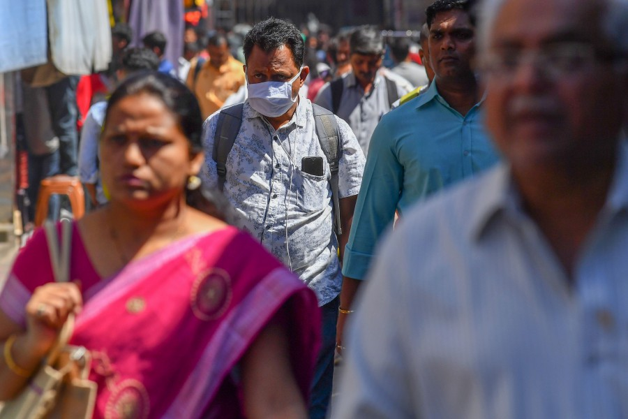 An Indian commuter wearing a facemask amid concerns over the spread of the COVID-19 coronavirus walks outside a railway station in Mumbai. - AFP pic