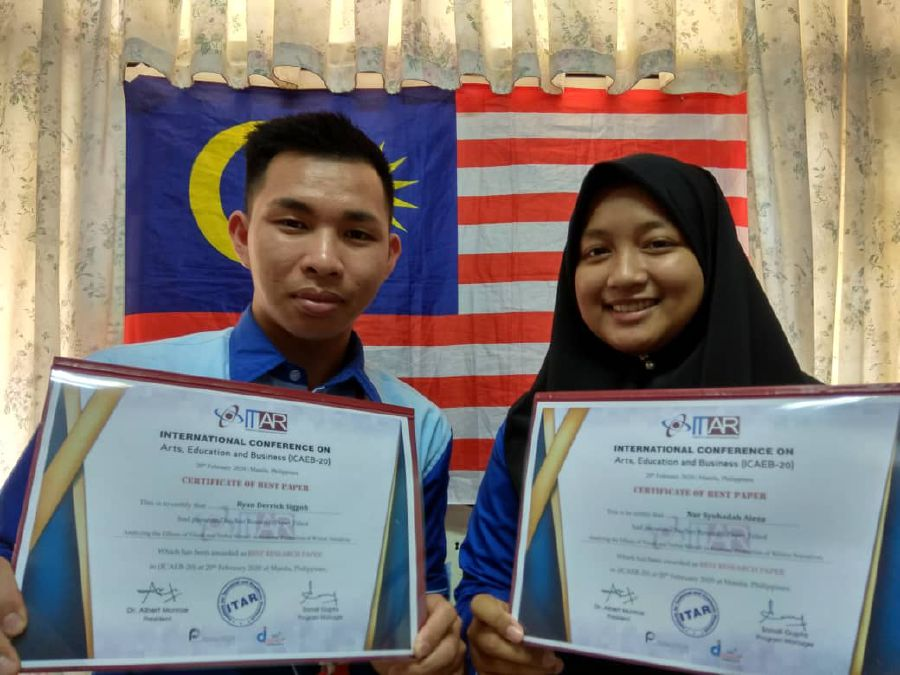 Ryan Derrick Siggoh and Nur Syuhadah Aieza showing their certificates of recognition for a joint research at the ICAEB which was held in Manila, Philippines, on Feb 20. - Pic courtesy of Dr Sirhajwan Idek
